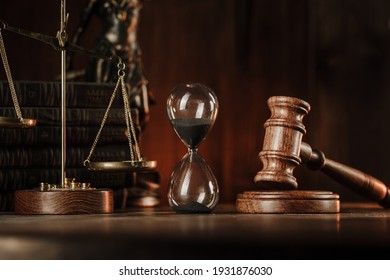 Judge gavel, scales and hourglass. Law and time concept