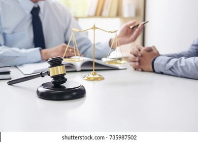 Judge gavel with scales of justice, Business people and male lawyers discussing contract papers at law firm in office. Concepts of law.