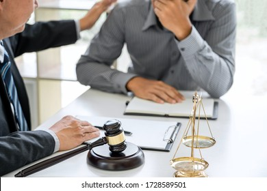 Judge gavel with scales of justice, Businessman and lawyer or counselor consulting and discussing contract papers at law firm in office.