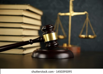 Judge gavel, scales of justice and law books in