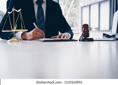 Judge gavel with scales of justice. Male lawyers working at the law firms. Legal law, lawyer, advice and justice concept.