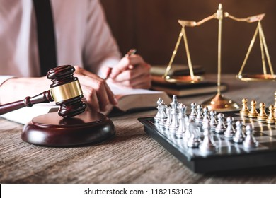Judge gavel with scales of justice, male lawyers working having at law firm in office. Concepts of law advice and justice.