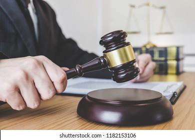 Judge gavel with scales of justice, professional male lawyers or counselor working having at law firm in office. Concepts of law.