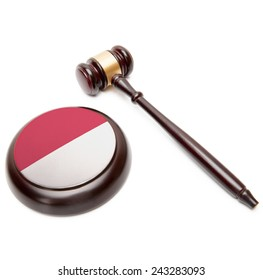 Judge gavel and soundboard with national flag on it - Monaco