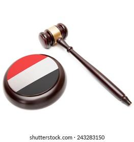 Judge gavel and soundboard with national flag on it - Yemen