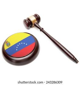 Judge gavel and soundboard with national flag on it - Venezuela