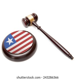 Judge gavel and soundboard with national flag on it - Liberia