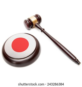 Judge gavel and soundboard with national flag on it - Japan
