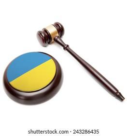 Judge gavel and soundboard with national flag on it - Ukraine