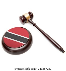 Judge gavel and soundboard with national flag on it - Trinidad and Tobago