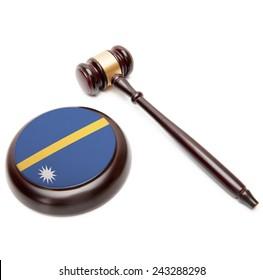Judge gavel and soundboard with national flag on it - Nauru