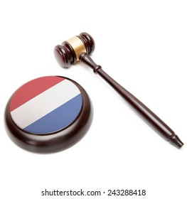 Judge gavel and soundboard with national flag on it - Netherlands