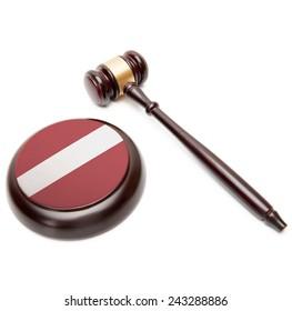 Judge gavel and soundboard with national flag on it - Latvia
