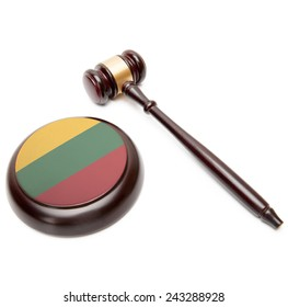 Judge gavel and soundboard with national flag on it - Lithuania