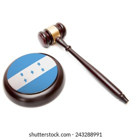 Judge gavel and soundboard with national flag on it - Honduras