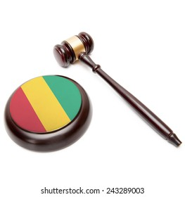 Judge gavel and soundboard with national flag on it - Republic of Guinea