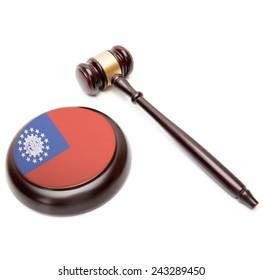 Judge gavel and soundboard with national flag on it - Burma