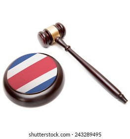 Judge gavel and soundboard with national flag on it - Costa Rica