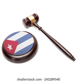 Judge gavel and soundboard with national flag on it - Cuba