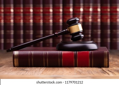 Judge Gavel And Soundboard On Law Book Over The Wooden Desk