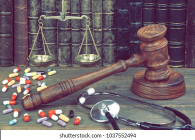 Judge Gavel, Stethoscope, Scale Of Justice, Many Pills And Law Books On Wooden Table. Medical Jurisprudence Concept. Legal Definition Of Medical Malpractice. Doctors And  Nurses Mistake.