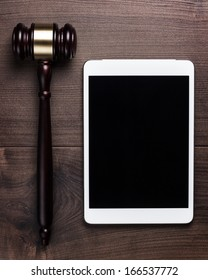 judge gavel and tablet computer on table cyber crime concept