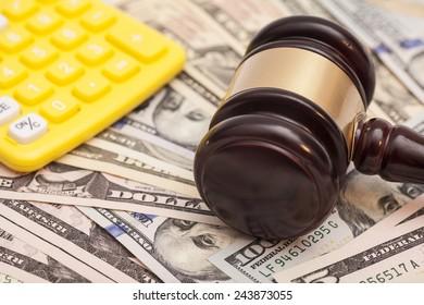 judge gavel,dollar banknotes and calculators