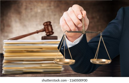 Judge hammer and documents on room background