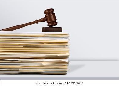 Judge hammer and documents on wooden table