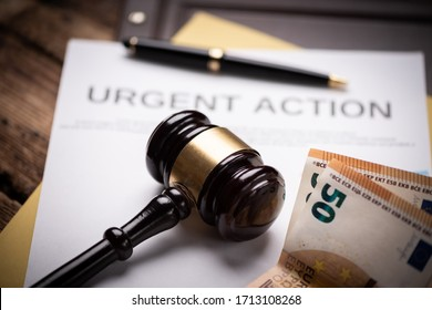 Judge hammer gavel  and euro money on a wooden desk. Close up