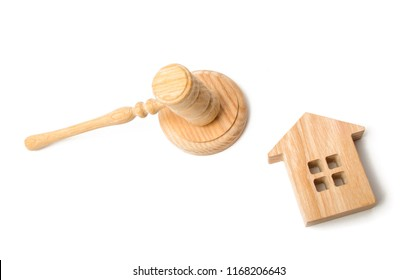 A judge hammer and a house on a white background. Concept settlement of litigation. Buying and selling real estate. Auction to buy a house or apartment. Forced eviction and confiscation.