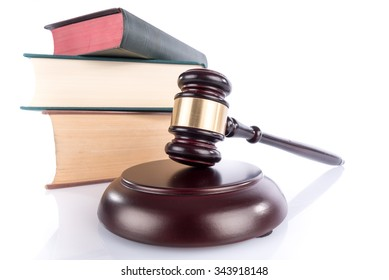 Judge hammer with law books, isolated on white
