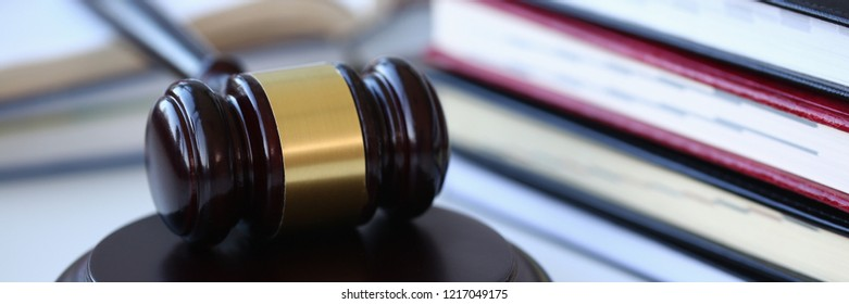 The judge hammer lies on table in debate room for fair judgments economic notions of violations legal system fraud and punishment