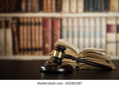 Judge hammer, scales of justice and law books in court
