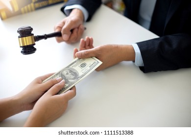 Judge lawyer gavel with bribe money in law firm concept corruption