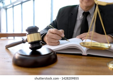 Judge or lawyer have gavel with  balance work in office  in law firm concept.