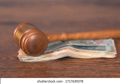 judge and money on the wooden table