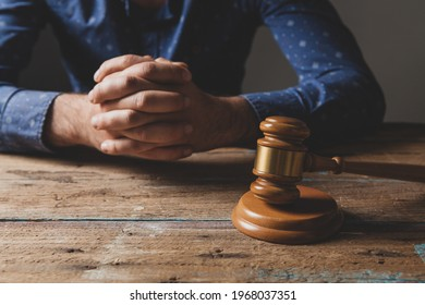 the judge sits in front of the hammer