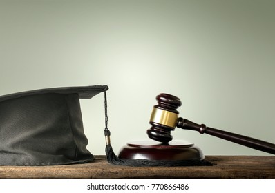 Judge Wood Hammer with congratulations graduates Law subjects concept.