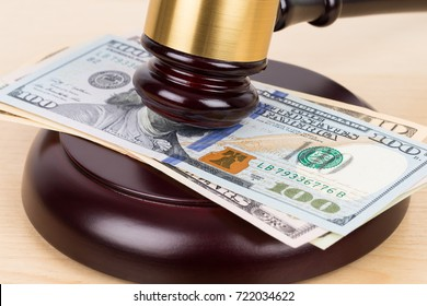 Judge wooden gavel with dollar money banknote concept for bribery