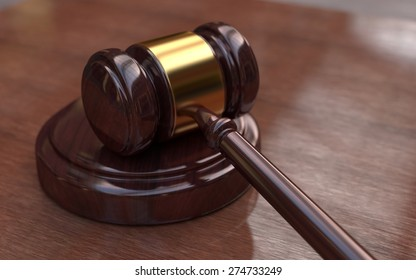 Judge, wooden gavel on the brown wooden background