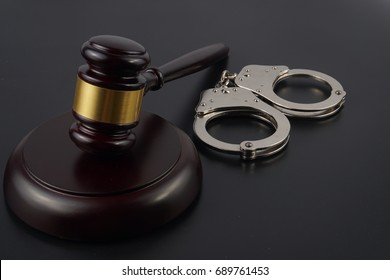Judgement Law Conceptual : Gavel and Handcuffs