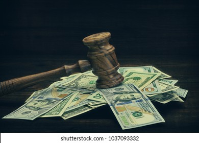 Judges or Auctioneers Gavel Or Hammer And USD Money Cash On Wooden Courtroom Bench Or Auctioneer Table. Grunge Wood Background. Law, Monetary, Auction Bidding, Bankruptcy, Bail, Or Tax Concept,