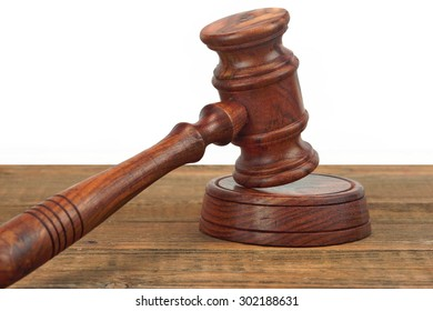 Judges Or Auctioneers Wood Rough Desk With Gavel On The Sound Board Isolated On White Background With Copy Space