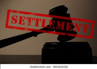 judges court gavel silhouette with Settlement stamp