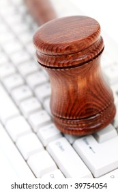 judge's courtroom gavel on computer keyboard