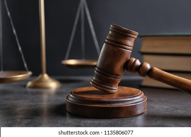 Judge's gavel and blurred scales on background. Law concept
