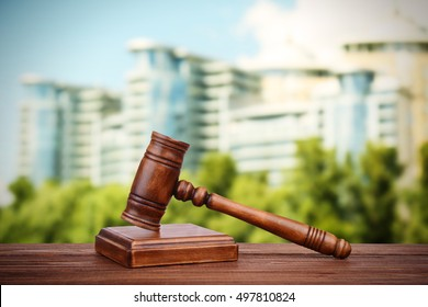 Judge's gavel and books on blurred building background