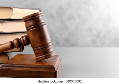 Judge's gavel and books on wall background