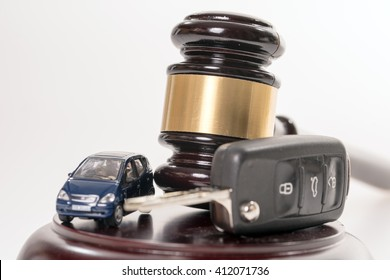 Judges gavel and car key / Traffic law